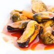Mussels in red sauce - Stock Photo