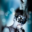 Beautiful woman with mask and wine — Stock Photo #2083603