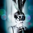 Beautiful woman with mask and wine — Stock Photo #2083617