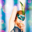 Beautiful woman with mask — Stockfoto