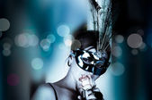 Beautiful woman with mask and wine — Stockfoto