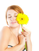 Beautiful woman with gerbera flower — Stock Photo