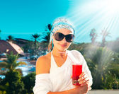 Girl with cocktail on the beach — Stock Photo