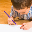 Photo: Boy draws pencils