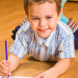 The boy draws pencils — Stock Photo #1596686