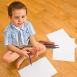 The boy draws pencils — Stock Photo #1596794