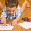 Boy draws pencils — Stock Photo #1597588