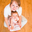 Mum and daughter look the book — Stock Photo #1597768