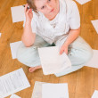 Stock Photo: Womworks with documents