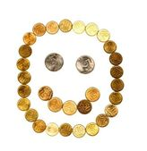 Smile composed of coins on white backgro — Stock Photo