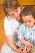 Mum and the son look the book — Stock Photo
