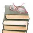 Stock Photo: Glasses at old books
