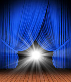 Blue theater curtain isolated on white — Stock Photo
