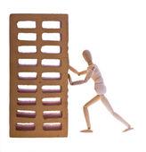 Dřevěný muž s cihlou — Stock fotografie