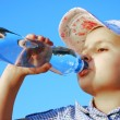 Pretty child drink fresh water - Stock fotografie