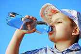 Pretty child drink fresh water — Stock Photo