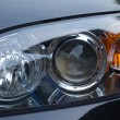 Modern car headlight background — Stock Photo
