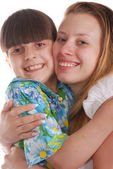 Lovely smiling sisters — Stock Photo