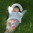 Stock Photo: Child rest on green grass