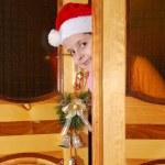 Christmas santa child look from door — Stock Photo