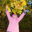 Funny happy child in autumn park — Stock Photo