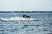Backlit jet ski with water spray — Stock Photo