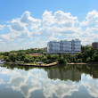 Cloudy blue sky reflection in calm water — Stock Photo #1759915