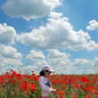 Pretty child at poppy meadow — Stock Photo