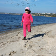 Stock Photo: Running child on river shore
