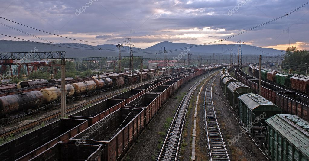 Photo of railway station with different trains — Stock Photo #1614269