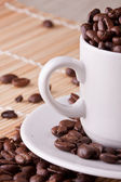 Cups with coffe grains — Stock Photo