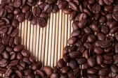 Coffee grains in the form of heart — Stock Photo