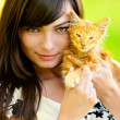 Portrait of girl with kitten - Stock Photo