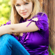 Portrait of girl in violet blouse. - Stock Photo