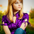 Portrait of girl in violet blouse - Stok fotoğraf