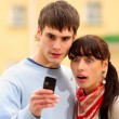 Two look at cellular telephone — Stock Photo #1596989