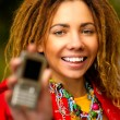 Girl with cellular telephone - Stock Photo