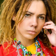 Royalty-Free Stock Photo: Girl  with dreadlocks speaks on phone