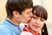 Kiss on cheek — Stock Photo
