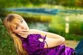 Girl lays near reservoir — Stock Photo