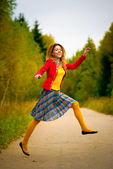 Girl with dreadlocks jumps — Stock Photo