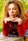 Girl with dreadlocks longs — Stock Photo