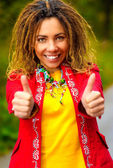 Girl with dreadlocks speaks - ok! — Stock Photo