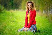 Girl with dreadlocks on meadow — Stock Photo