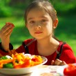 Stock Photo: Girl eats vegetables