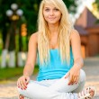 Girl in lotus pose - Stockfoto