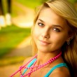 Blonde with beads — Stock Photo #1602342