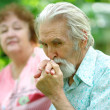 Elderly man kisses a hand of the wife — Stock Photo