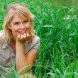 Stock Photo: Girl in a grass