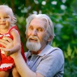 Grandfather and grand daughter - Stock Photo